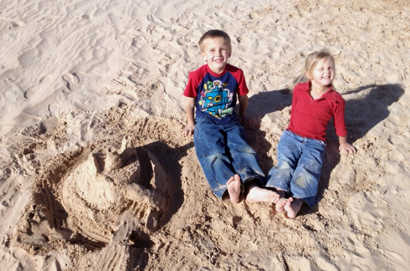 We built a sand castle down at Lonerock. Dad did not do a great job on it. But the kids don't know that ;)