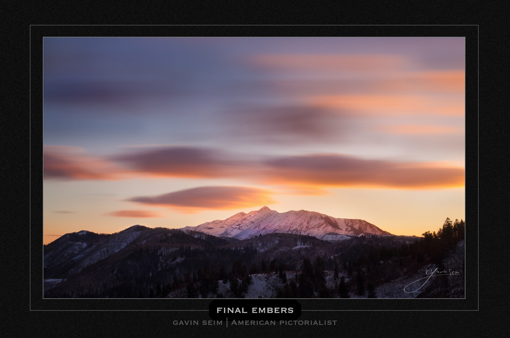 Final Embers - Pastel clouds drift by mount Nebo in Utah reflecting light onto the snow capped peaks.